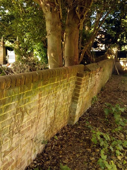 St. Clements Church boundary wall before rebuilding and tree removal